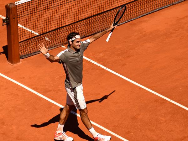 """""""לשחק טניס זה כיף"""" (Getty)"""
