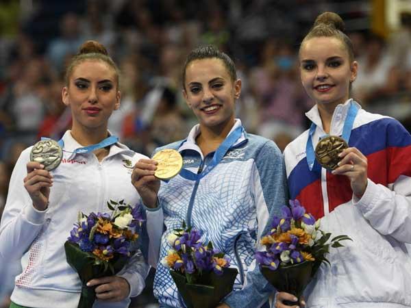 אשרם על הפודיום, סיום ענק לתחרות (צילום: עמית שיסל, באדיבות הוועד האולימפי בישראל)