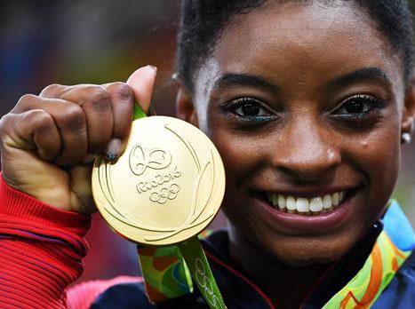 4 מדליות זהב (GETTY)